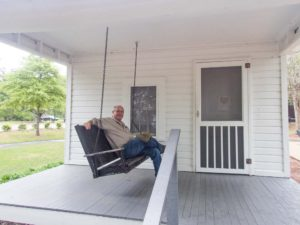 Doug swinging on Elvis' porch singing of course!