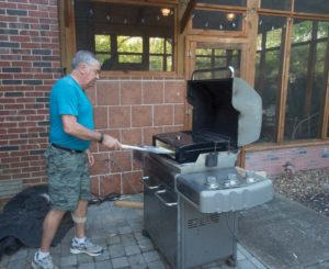 Chef Bob dueling with his famous pizza oven. He won this time!